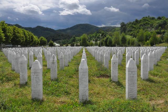 Srebrenica memorial headstones in a green field