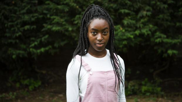 Teenage girl standing outside
