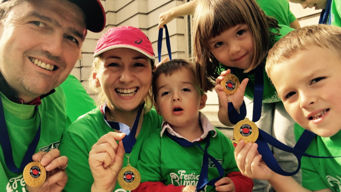 Family with medals after completing an event
